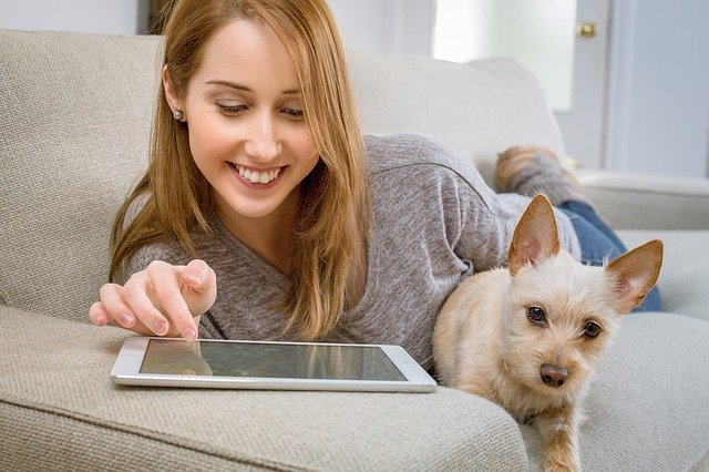 Woman with touchscreen tablet