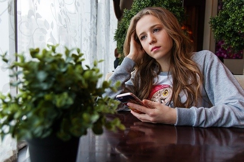 teen girl with phone