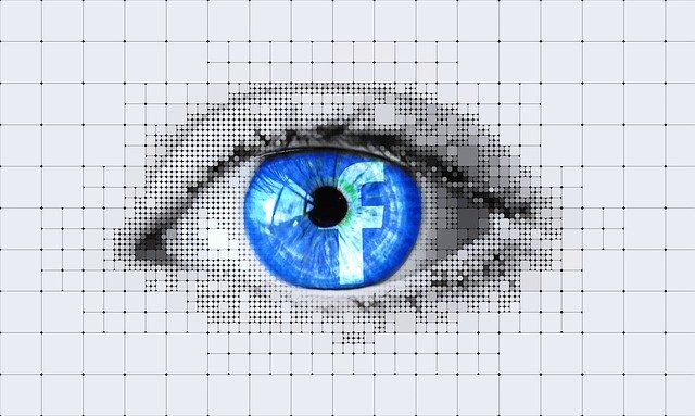 eye with facebook logo reflected in it - Facebook status